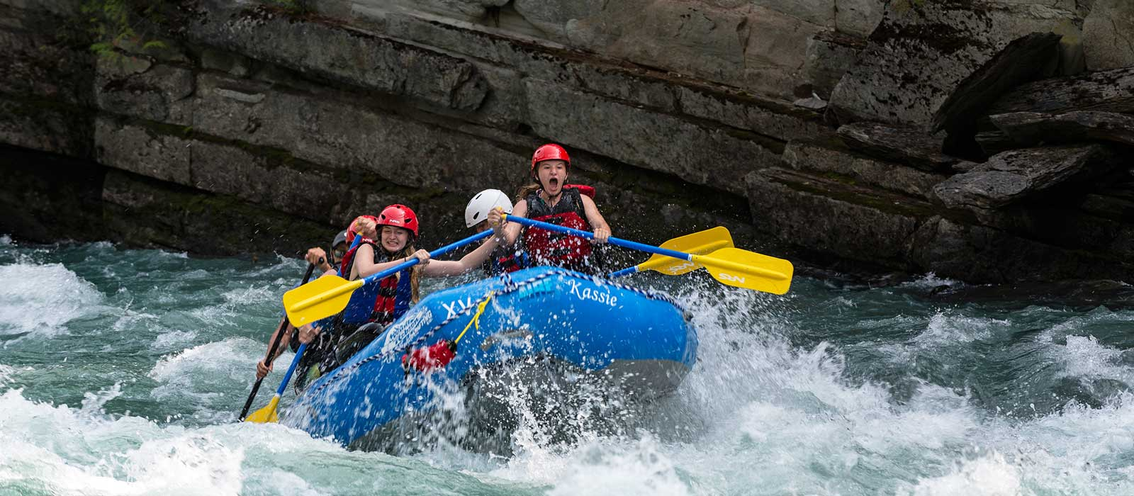 Whitewater rafters bouncing through the rapids