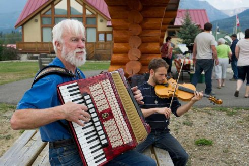 Accordion and fiddle players at local event