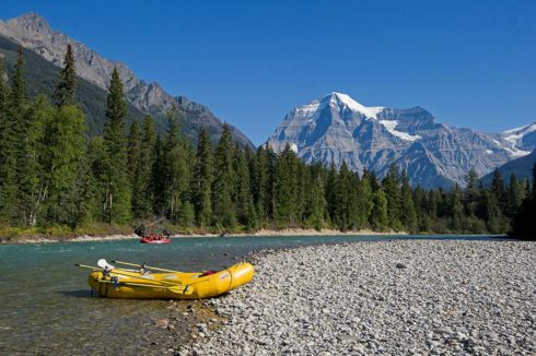 Gorgeous scene of turquoise river with rafts and Mount Robson in the background