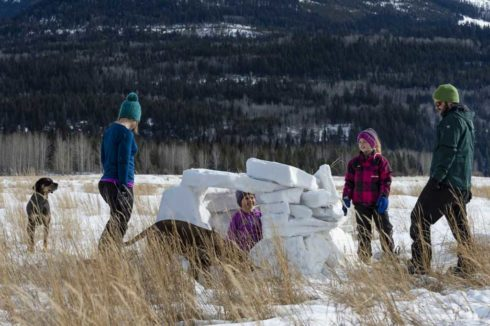 Family building an igloo